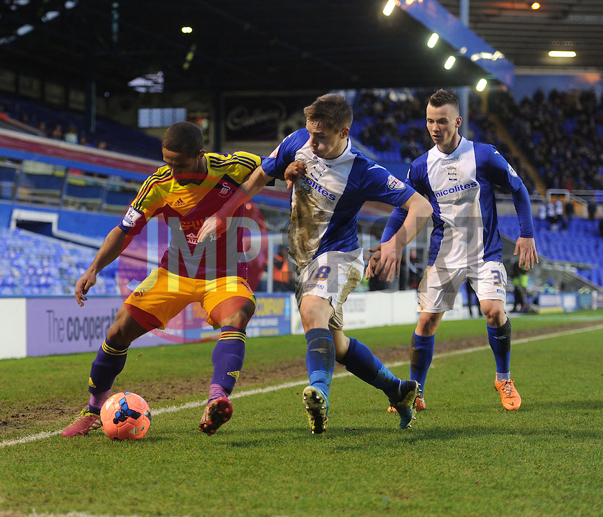 Swansea City's Wayne Routledge shields the ball from Birmingham City's Mitch Hancox - Photo mandatory by-line: Alex James/JMP - Tel: Mobile: 07966 386802 25/01/2014 - SPORT - FOOTBALL - St Andrew's - Birmingham - Birmingham City v Swansea City - FA Cup - Forth Round