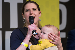 London, UK. 23rd March, 2019. Jo Swinson MP, Deputy Leader of the Liberal Democrats, introduces her son Gabriel as she addresses a million people taking part in a People's Vote rally in Parliament Square following a march from Park Lane.
