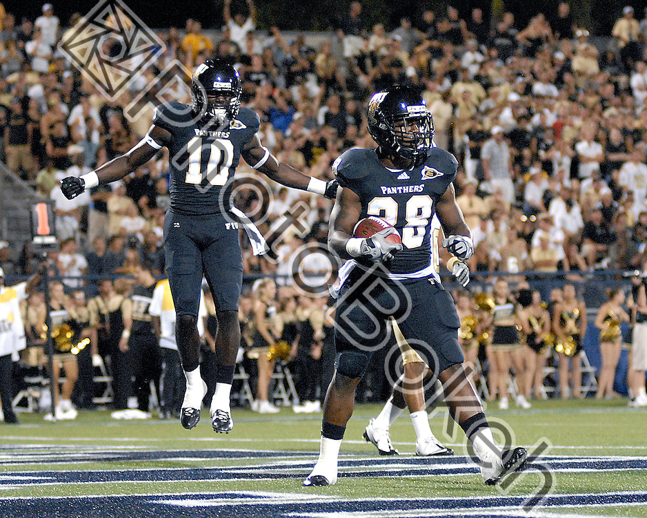 2011 September 17 - Florida International wide receiver Glenn Coleman (10) celebrating with Florida International running back Darriet Perry (28). Florida International University Golden Panthers defeated the Golden Knights of the University of Central Florida, 17-10, at the FIU Football Stadium, Miami, Florida. (Photo by: www.photobokeh.com / Alex J. Hernandez)