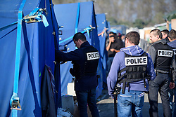 © Licensed to London News Pictures. 25/10/2016. Calais, France.  French police search tents at the migrant and refugee camp in Calais, known as the 'Jungle'. French authorities have moved thousands of refugees and migrants living at the makeshift living area on the French coast, with some still refusing to leave. . Photo credit: Ben Cawthra/LNP