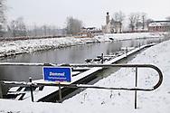 Nederland, Vught, 20100104.<br /> Kasteel Herlaar met sneeuw. De rivier de Dommel stroomt langs het net gerestaureerde kasteel. Bordje met opschrift &quot;dommel&quot; aan een reling.<br /> <br /> Netherlands, Vught, 20100104.<br /> Castle Herlaar with snow. The Dommel river flows past the castle, just restored. Plate with inscription &quot;Dommel&quot; to a railing.