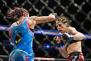DALLAS, TX - MARCH 14:  Joanna Jedrzejczyk avoids a punch from Carla Esparza during UFC 185 at the American Airlines Center on March 14, 2015 in Dallas, Texas. (Photo by Cooper Neill/Zuffa LLC/Zuffa LLC via Getty Images) *** Local Caption *** Joanna Jedrzejczyk; Carla Esparza