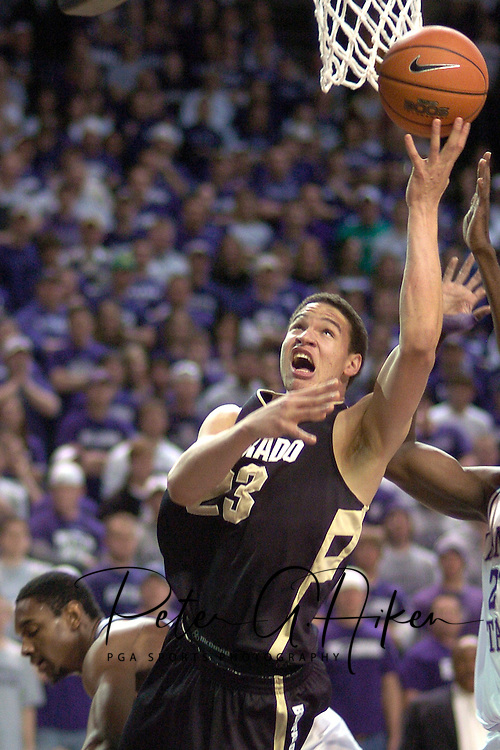 Colorado guard Richard Roby (23) drives to the basket past Kansas State's Akeem Wright (lower left) in the first half.  The Buffaloes lead at halftime 30-26.