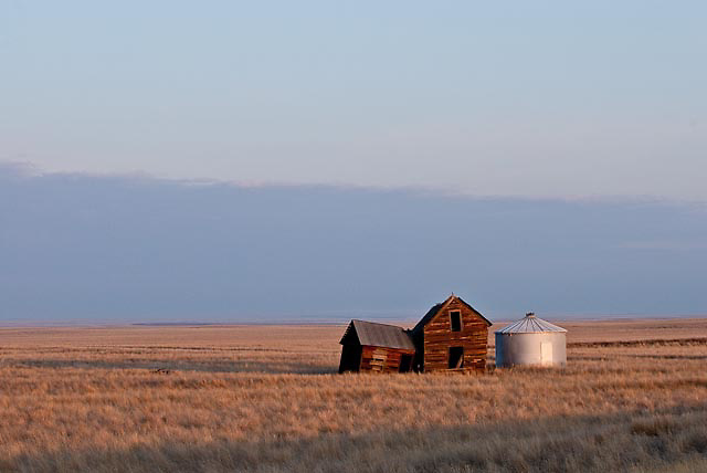 russel country, montana, usa, old farm house and grain silo, montana short grass prarie,, russell