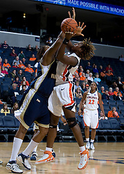 Virginia Cavaliers C Aisha Mohammed (33) is fouled by George Washington Colonials C/F Jessica Adair (1).  The Virginia Cavaliers women's basketball team fell to the #14 ranked George Washington Colonials 70-68 at the John Paul Jones Arena in Charlottesville, VA on November 12, 2007.