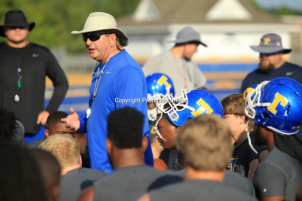 Tupelo High School Head Football Coach Trent Hammond talks with his team before the start of practice Monday afternoon at Tupelo High School.