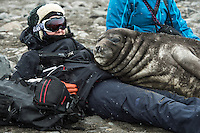 Lea enjoying a peaceful moment with a curious Elephant Seal cub on the Livingstone Island in Antarctica.