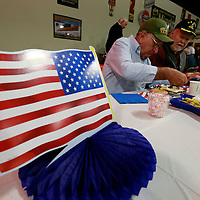 Thomas Wells | BUY AT PHOTOS.DJOURNAL.COM<br /> Hollis Lindley, left, and Bob Bethany enjoy a Veterans Day breakfast held on Wednesday at the Tupelo Automobile Muesum.