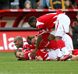 London, England - Saturday, January 12th, 2008:  Charlton Athletic's Luke Varney (bottom) celebrates the second Charlton goal against Blackpool during the League Championship match at The Valley. (Pic by Chris Ratcliffe/Propaganda)
