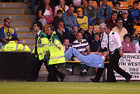 Photo: Rich Eaton.<br /> <br /> Torquay United v Norwich City. Carling Cup. 23/08/2006. Andrew Cave-Brown of Norwich City is carried from the pitch after receiving an injury