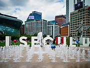 SEOUL, SOUTH KOREA: People play on the splash pad in front of Seoul City Hall and Seoul Plaza in Seoul, South Korea.       PHOTO BY JACK KURTZ