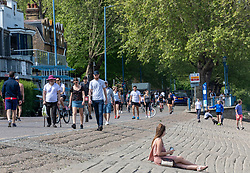 © Licensed to London News Pictures. 26/04/2020. London, UK. Members of the public go out to enjoy the warm weather on Putney Embankment which looked busy today during lockdown where temperatures are expected to reach 21c. London has seen an increase in traffic and busier High Streets as more shops and cafes start to open up during the coronavirus pandemic crisis. Photo credit: Alex Lentati/LNP
