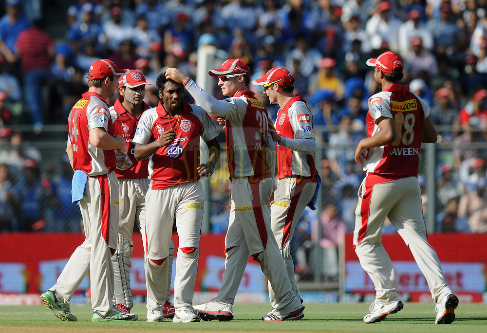 Parvinder Awana of Kings XI Punjab celebrate the wicket of Rohit sharma of Mumbai Indians during match 28 of the Indian Premier League ( IPL) 2012  between The Mumbai Indians and the Kings X1 Punjab held at the Wankhede Stadium in Mumbai on the 22nd April 2012..Photo by Pal Pillai/IPL/SPORTZPICS.