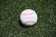 LOS ANGELES, CA - MAY 12:  A baseball with pink seams lies on the grass before being used in the Los Angeles Dodgers game in honor of Mother's Day during the game against the Miami Marlins on Sunday, May 12, 2013 at Dodger Stadium in Los Angeles, California. The Dodgers won the game 5-3. (Photo by Paul Spinelli/MLB Photos via Getty Images)