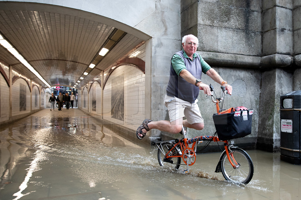 © Licensed to London News Pictures. 30/09/2019. London, UK. A cyclist negotiates a large area of water caused by flooding under a bridge near Blackfriars in Central London. Heavy rainfall is forecast for early this week. Photo credit : Tom Nicholson/LNP