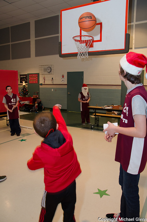 "19 Dec. 2013 Manahawkin USA // Students answer math questions and get to shoot the hoops in their annual ""Winter Wonderland"" Math exhibit"