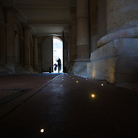 A modern touch in an old palace: in-ground pin-point lights line a walkway in the massive Palace of the Dukes of Burgundy in Dijon, providing a subtle element of class in the former Royal complex.