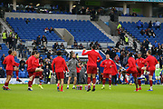 Liverpool players warm up during the Premier League match between Brighton and Hove Albion and Liverpool at the American Express Community Stadium, Brighton and Hove, England on 12 January 2019.