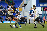 Fulham midfielder Rohan Ince tackles Birmingham City striker Clayton Donaldson during the Sky Bet Championship match between Birmingham City and Fulham at St Andrews, Birmingham, England on 19 March 2016. Photo by Alan Franklin.