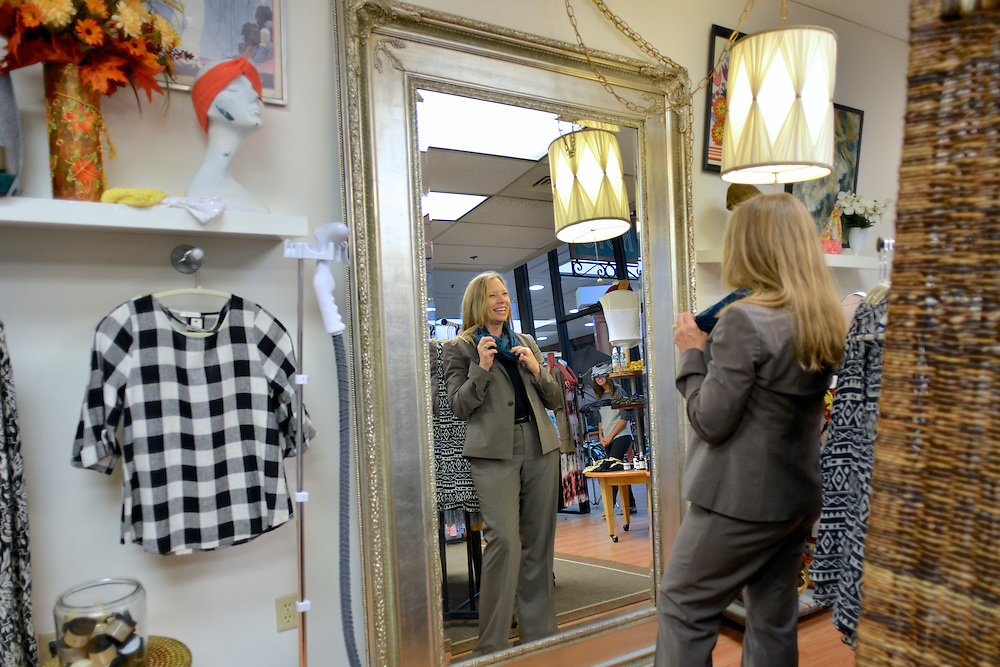 Female guest looking at clothes for sale at NOTO Boutique.