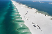 Parking lots and roads are temporarily abandoned on this barrier island as a result of a succession of tropical storms and hurricanes in 2004 and 2005.