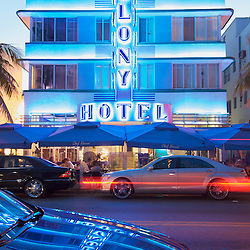 The Colony Hotel's art deco facade illuminated at night in South Beach, Miami.