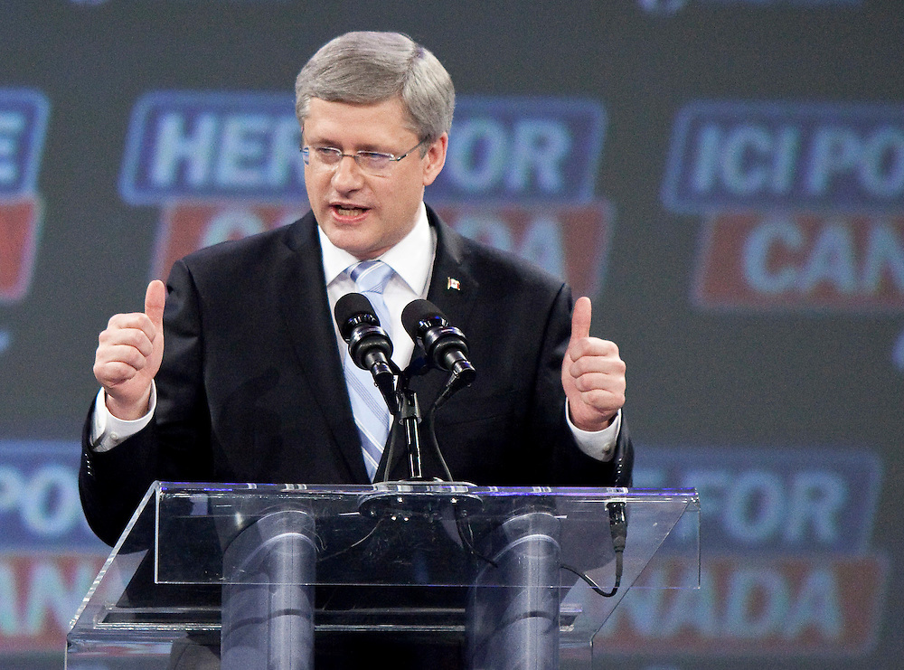 Conservative leader Stephen Harper speaks to supporters gathered at the Telus Convention Centre in Calgary, Alberta, May 2, 2011 following the election of a Conservative majority government in Canada's federal election.<br /> AFP/GEOFF ROBINS/STR