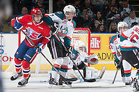 KELOWNA, CANADA - MARCH 7: Devon McAndrews #15 of Spokane Chiefs looks for the pass in front of the net of Jackson Whistle #1 while Lucas Johansen #7 of Kelowna Rockets back checks on March 7, 2015 at Prospera Place in Kelowna, British Columbia, Canada.  (Photo by Marissa Baecker/Shoot the Breeze)  *** Local Caption *** Jackson Whistle; Devon McAndrews; Lucas Johansen;