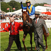 Epsom Derby 2003..Winning horse & jockey being paraded with owner..