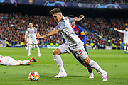 Liverpool striker Roberto Firmino (9) goes past Barcelona forward Lionel Messi (10) during the Champions League semi-final leg 1 of 2 match between Barcelona and Liverpool at Camp Nou, Barcelona, Spain on 1 May 2019.
