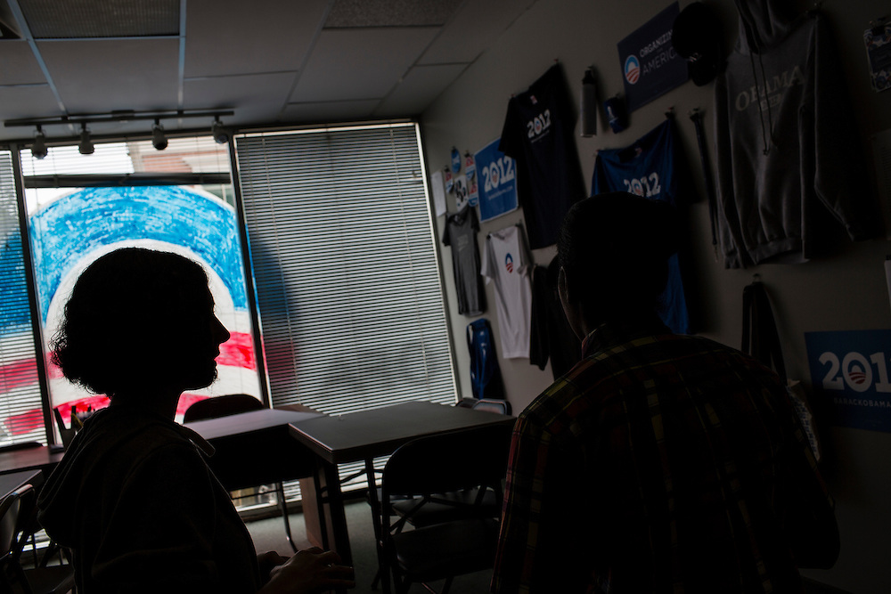 Bridgit Donnelly, left, regional field director with Organizing for America, President Obama's re-election campaign arm, talks with a volunteer in the group's Richmond headquarters on Thursday, May 3, 2012 in Richmond, VA.