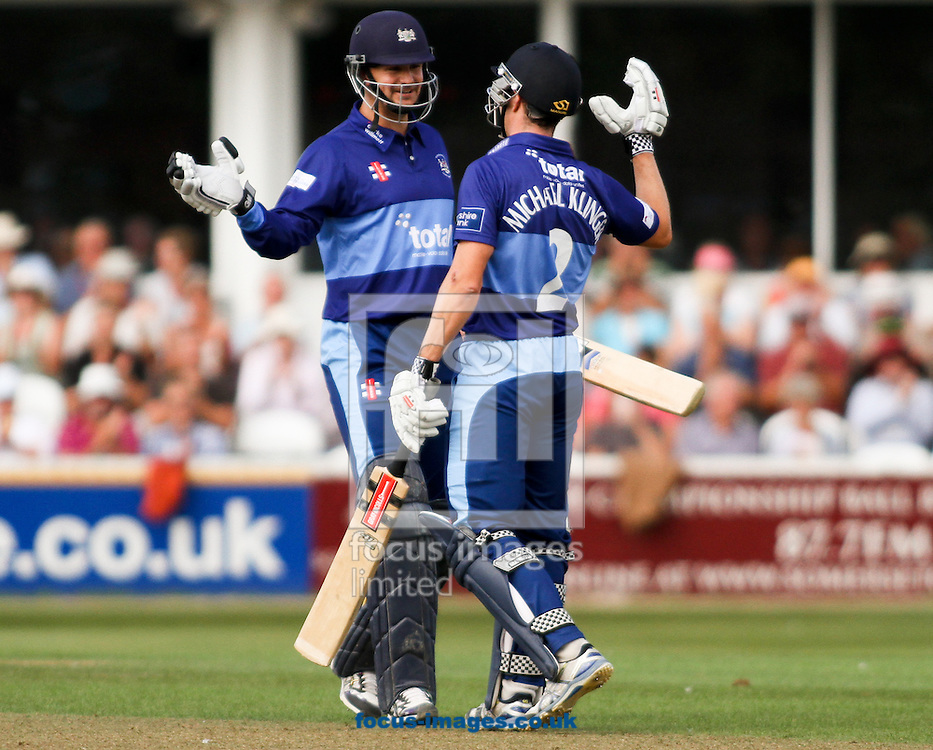 Picture by Tom Smith/Focus Images Ltd 07545141164<br /> 11/08/2013<br /> Alex Gidman (left) congratulates Michael Klinger (right) of Gloucestershire Gladiators on reaching his century during the Yorkshire Bank 40 match at the County Ground, Taunton, Taunton.