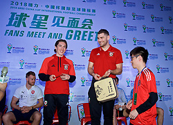 NANNING, CHINA - Saturday, March 24, 2018: Wales' Harry Wilson and Sam Vokes are presented with a China tea set by supporters during a meet & greet event at the Nanning Wanda Mall during the 2018 Gree China Cup International Football Championship. (Pic by David Rawcliffe/Propaganda)