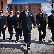 05/21/11 Baltimore MD: Gregg Fornario walking from the hotel with his groomsmen as his gets ready to  celebrate his new life with his wife in front of family and friends as they tie the knot Saturday, The Twenty First of May Two Thousand and Eleven at 1840's Ballroom in Baltimore Maryland.<br /> <br /> Special to Monsterphoto/SAQUAN STIMPSON<br /> <br /> Special to Monsterphoto/SAQUAN STIMPSON