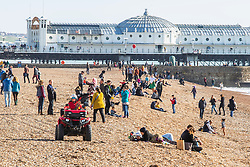 © Licensed to London News Pictures. 27/10/2019. Brighton, UK. Members of the public take advantage of the sunshine by spending time on the beach and promenade in Brighton and Hove. Photo credit: Hugo Michiels/LNP