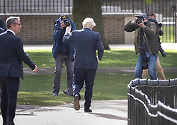 © Licensed to London News Pictures. 11/05/2020. London, UK. Prime Minister Boris Johnson is photographed as he takes a morning walk in St James's Park in central London. The Prime Minister has announced a few changes to the lockdown rules. Photo credit: Peter Macdiarmid/LNP