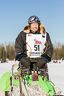 Musher Jim Lanier competing in the 44th Iditarod Trail Sled Dog Race on Long Lake after leaving the restart on Willow Lake in Southcentral Alaska.  Afternoon. Winter.