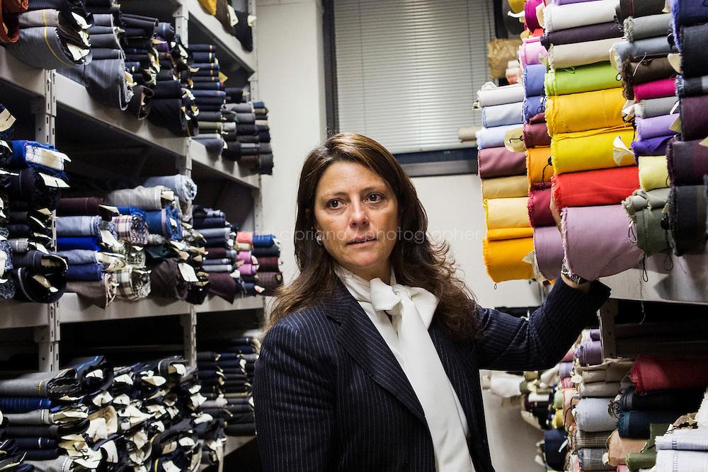 ARZANO, ITALY - 16 January 2014:  Maria Giovanna Paone, Vice President and General Manager of Kiton, checks a fabric at the blazer division of the Kiton factory in Arzano, Italy, on January 16th 2014.