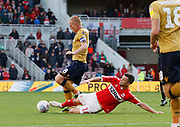 Nottingham Forest midfielder Ben Watson (8) is tackled by Middlesbrough midfielder Jonathan Howson (16)  during the EFL Sky Bet Championship match between Middlesbrough and Nottingham Forest at the Riverside Stadium, Middlesbrough, England on 6 October 2018.