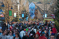 People stroll along the Town Plaza in Whistler Village during the 2010 Olympic Winter Games in Whistler, BC Canada.