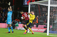 Football - 2019 / 2020 Emirates FA Cup - Fourth Round: AFC Bournemouth vs. Arsenal<br /> <br /> Bournemouth's Callum Wilson wrestles the ball from Rob Holding of Arsenal during the FA Cup match at the Vitality Stadium (Dean Court) Bournemouth <br /> <br /> COLORSPORT/SHAUN BOGGUST
