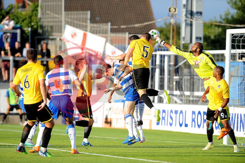 Reading's Ali Al Habsi punches clear from James Clarke of Bristol Rovers - Mandatory by-line: Neil Brookman/JMP - 21/07/2015 - SPORT - FOOTBALL - Bristol,England - Memorial Stadium - Bristol Rovers v Reading - Pre-Season Friendly
