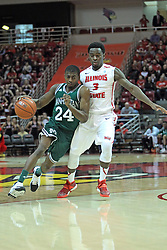 20 November 2013:  George Beamon scoots past Daishon Knight as he heads for the lane during an NCAA Non-Conference mens basketball game between theJaspers of Manhattan and the Illinois State Redbirds in Redbird Arena, Normal IL