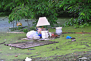 "8/11/11} Vicksburg} -- Vicksburg, MS, U.S.A. -- Things unable to be rescued from homes in the North Kings Commmunity float in the water Wed. May 11,2011. Mark Bridges,56, thrift store owner, and his dog ""baby girl"" and his girlfriend of 12 years Patricia Clark, a homeDepot garden employee, cruise down Chicksaw Rd in a bass boat in North Kings Community in Vicksburg Mississippi Wed. May 5th 2011. This is the firs time for Patricia to try and remove things from her trailer, that is built on 9ft stilts  AND THE WATER IS CURRENTLY AT 15 ft. and rising and is less than 12 inches from being flooded. Mark and Patricia have lived their all their lives and will return when the Mississippi River recedes,. ark has been helping his neighbors get their belongings to safety. Vicksburg a riverfront town steeped in war and sacrifice, gets set to battle an age-old companion: the Mississippi River. The city that fell to Ulysses S. Grant and the Union Army after a painful siege in 1863 is marshalling a modern flood-control arsenal to keep the swollen Mississippi from overwhelming its defenses. PHOTO©SUZIALTMAN.COM.Photo by Suzi Altman, Freelance."