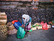 11 OCTOBER 2016 - UBUD, BALI, INDONESIA: A Muslim woman who sells used bags in the market in Ubud. Bali is a Hindu majority island in Indonesia, a Muslim majority country. Many Muslims from Java are moving to Bali because Bali's economy is better than the economy on neighboring islands. The morning market in Ubud is for produce and meat and serves local people from about 4:30 AM until about 7:30 AM. As the morning progresses the local vendors pack up and leave and vendors selling tourist curios move in. By about 8:30 AM the market is mostly a tourist market selling curios to tourists. Ubud is Bali's art and cultural center.      PHOTO BY JACK KURTZ