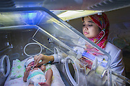 In a hospital in Jakarta Indonesia, Dr. Ribkhi looks at a newborn child who has jaundice.