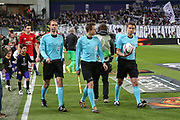 Referee Felix Brych leads the two tams out during the UEFA Europa League Quarter-final, Game 1 match between Anderlecht and Manchester United at Constant Vanden Stock Stadium, Anderlecht, Belgium on 13 April 2017. Photo by Phil Duncan.