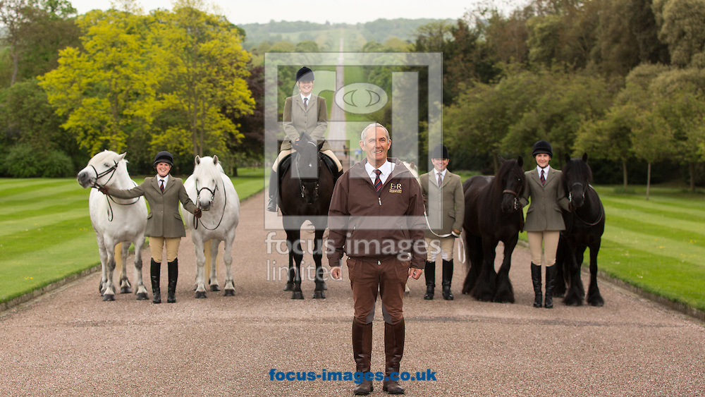 The Queen&rsquo;s horses, of all shapes and sizes, on parade to welcome over 50,000 visitors to the Royal Windsor Horse Show, running  13-17/5/15. Her Majesty The Queen, who has attended the show every year since it began in 1943, has several entries including her home bred Highlands and her former racehorse, Barber&rsquo;s Shop.<br /> <br /> Shown:<br /> <br /> Front:<br /> Terry Pendry, Stud Groom and Manager<br /> <br /> Horses from left to right: Alpine, Mingulay, George (named after Her Majesty the Queen&rsquo;s Father), Anson, Dawn and Emma (the Queen's own riding pony)<br /> Grooms from left to right: Harriet White, Zoe McDonald, Christopher Allen and Sadie Henderson<br /> <br /> <br /> Picture by Mark Chappell/Focus Images Ltd +44 77927 63340<br /> 12/05/2015
