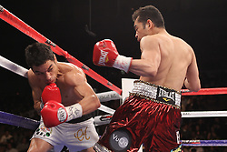 February 19, 2011; Las Vegas, NV; USA; Nonito Donaire knocks out Fernando Montiel in the second round of their main event bout on HBO's Boxing After Dark.  Photo Ed Mulholland/HBO NO SALES