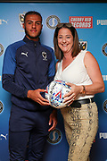 AFC Wimbledon defender Nesta Guinness-Walker (18) getting man of the match award  during the EFL Sky Bet League 1 match between AFC Wimbledon and Wycombe Wanderers at the Cherry Red Records Stadium, Kingston, England on 31 August 2019.